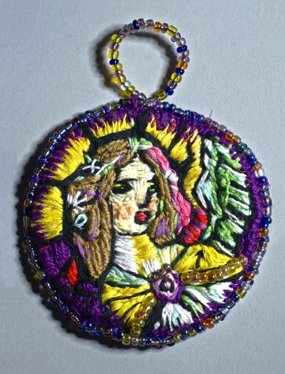 Angel with yellow halo medallion