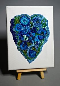 Blue heart on canvas
