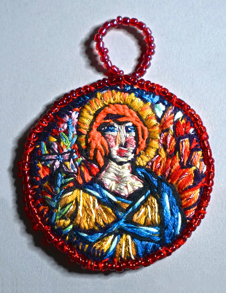 Orange haired angel medallion