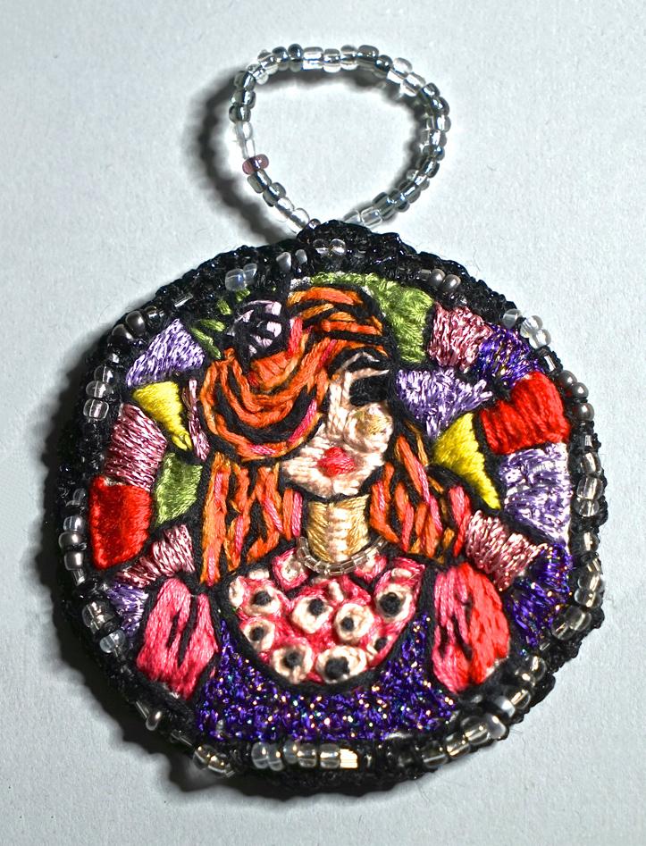 Redhead girl medallion