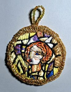 Redhead girl medallion with gold border