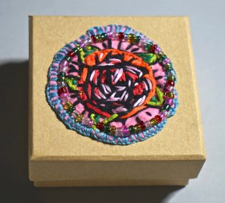 Small square wooden box with orange rose centre