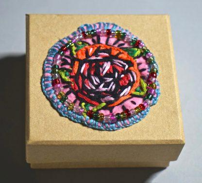 Small square wooden box with orange rose centre