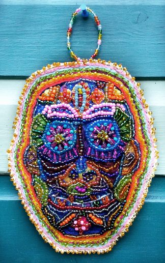 Beaded skull wall hanging