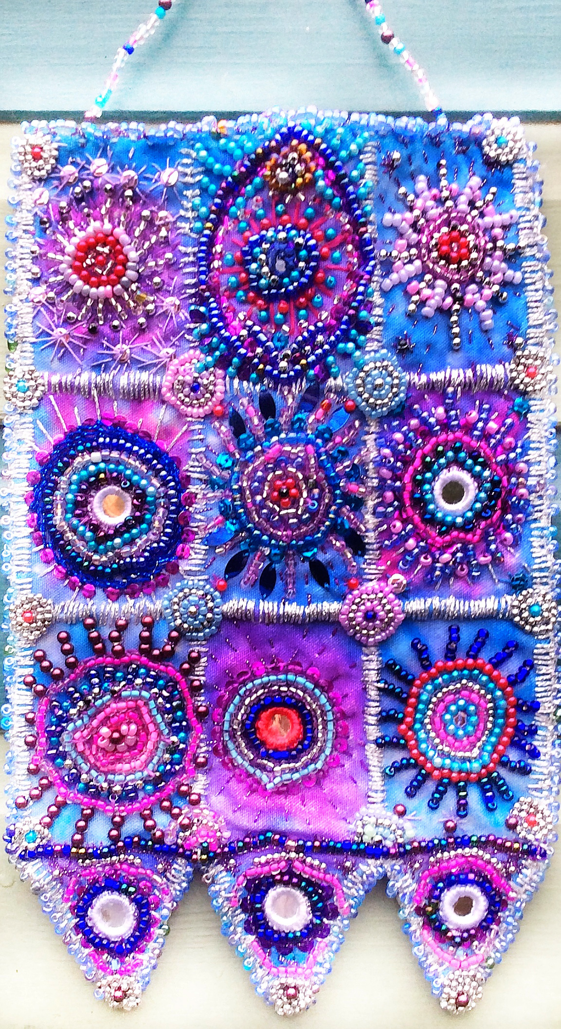 Beaded wall hanging in blue